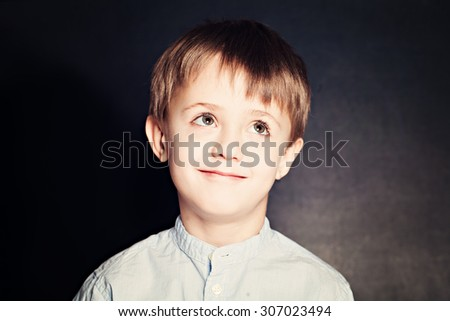 Cute Child School Boy on Blackboard Background - stock photo
