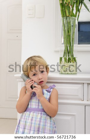 cute child talking on phone at home