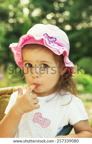 Cute child with big clear eyes impressively looking at the camera. Close-Up. - stock photo