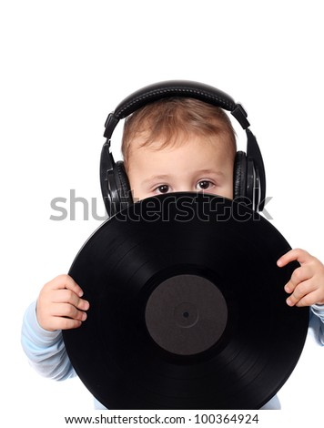 Cute child with music disk - stock photo