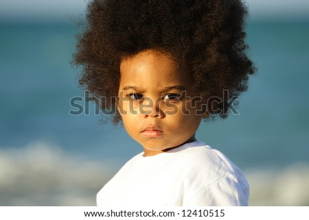 Cute child with water background - stock photo