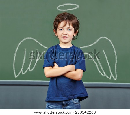Cute child with wings and halo as guardian angel - stock photo