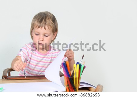 cute child wrting over white