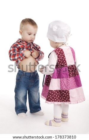 Cute children are playing doctor with stethoscope - stock photo