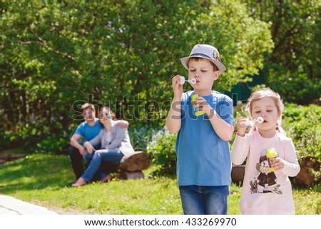 Cute Children are Playing in Park - stock photo