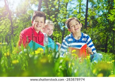 Cute children having rest in park - stock photo