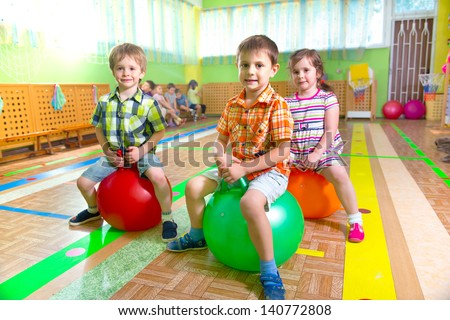 Cute children playing in kindergarten gym - stock photo