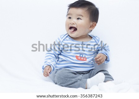 Cute Chinese baby boy in sailor suit, shot in Beijing, China