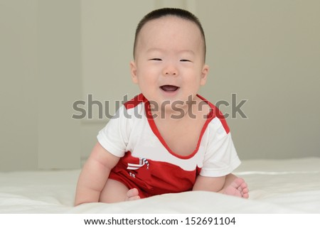 Cute Chinese boy sitting for the camera