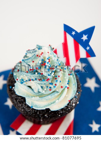 Cute Chocolate Cupcake with Blue Frosting and Star Decorated for Independence Day - stock photo