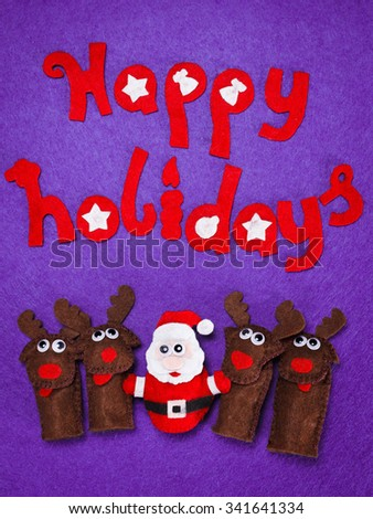 Cute Christmas toys of Santa and reindeer with the words Happy Holiday from felt - stock photo