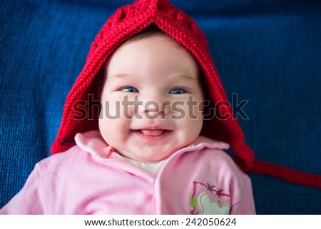 Cute close up portrait of laughing baby - stock photo