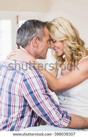 Cute couple about to kiss in the living room