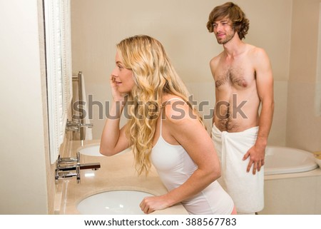 Cute couple getting ready in the bathroom