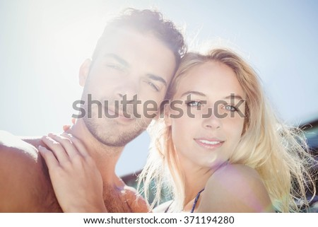 Cute couple hugging by the pool - stock photo