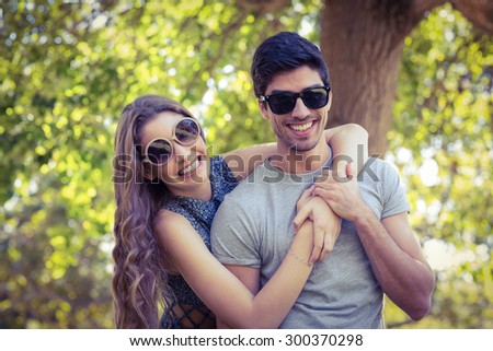 Cute couple in the park on a sunny day