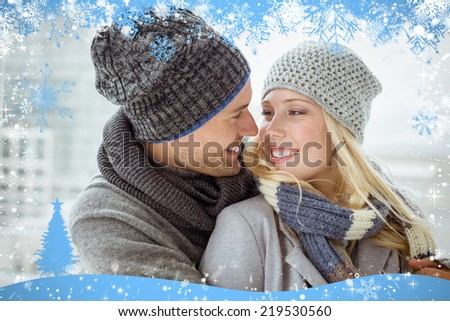 Cute couple in warm clothing smiling at each other against snow - stock photo
