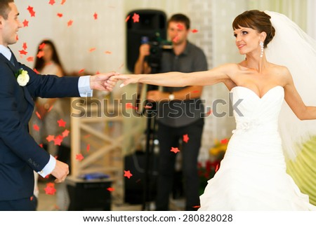 cute couple is dancing on the  background restaurant - stock photo