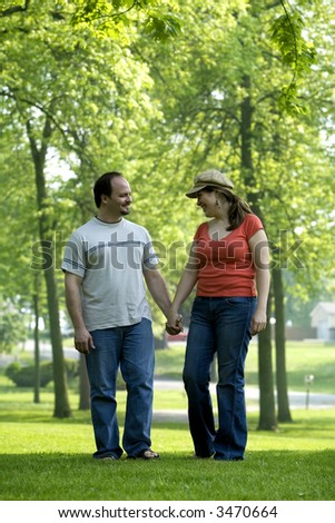 cute couple on a date walking through a park