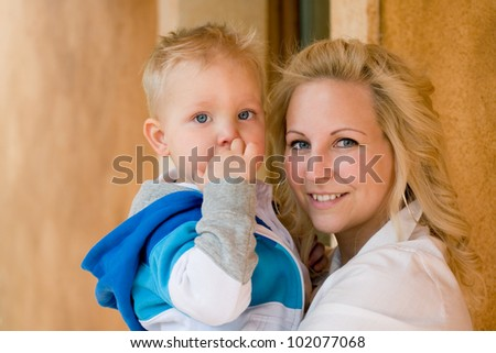 Cute couple, portrait of young attractive mom and her son. - stock photo