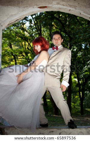 Cute couple posing in forest