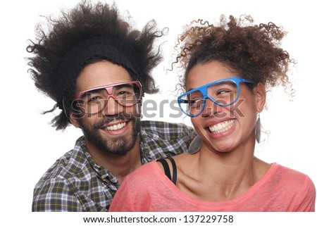 Cute couple posing with glasses - stock photo