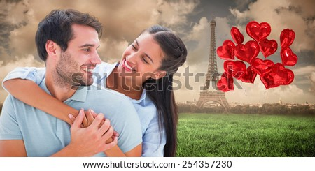 Cute couple smiling at each other against paris under cloudy sky - stock photo