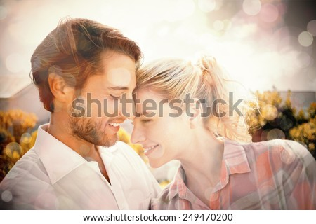 Cute couple spending time together outside on a sunny day - stock photo