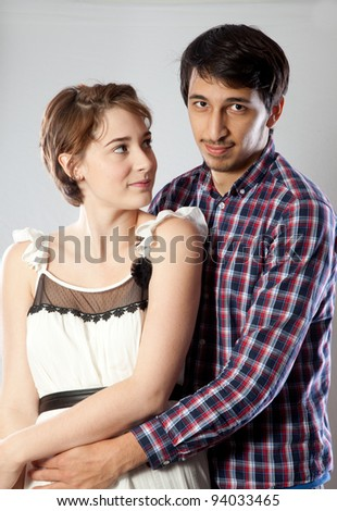 Cute couple with a loving embrace and a romantic touch