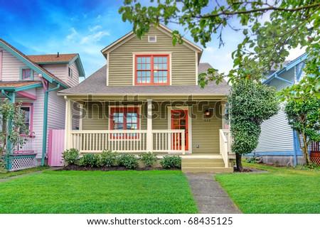 Cute craftsman style small green house. Tacoma, USA. - stock photo