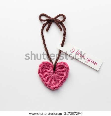 Cute crochet heart with Love Yarn tag - stock photo