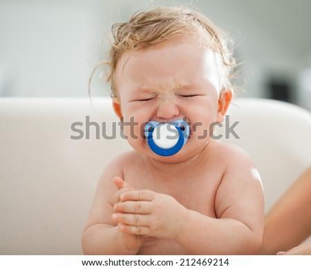 Cute Cucasian baby boy crying. - stock photo