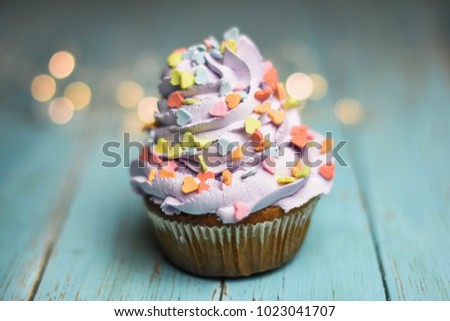 Cute cupcake decorated with hearts