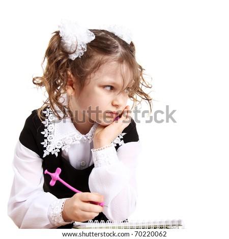 cute displeased little school girl in uniform - stock photo