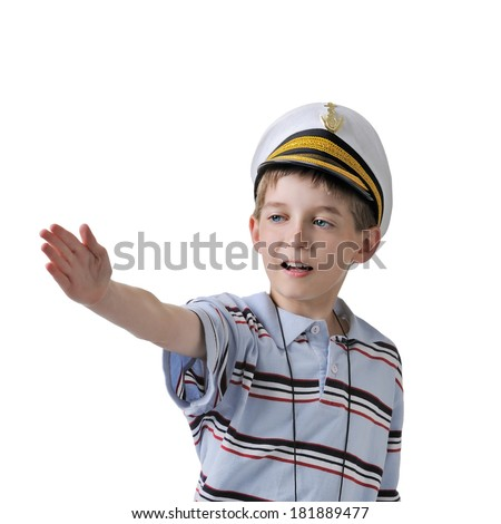 Cute dreaming boy in captain cap. isolated over white background.