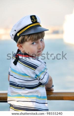 Cute dreaming child in captain cap. - stock photo