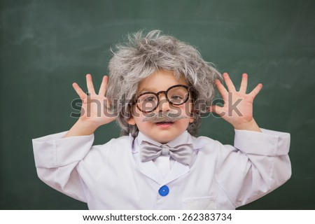 Cute dressed up pupil showing his hands at elementary school - stock photo