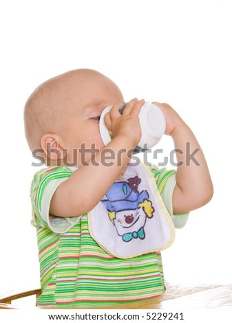 Cute drinking child with cup. Isolated over white - stock photo