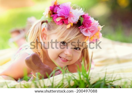 cute easter girl with chocolate bunny outdoor - stock photo