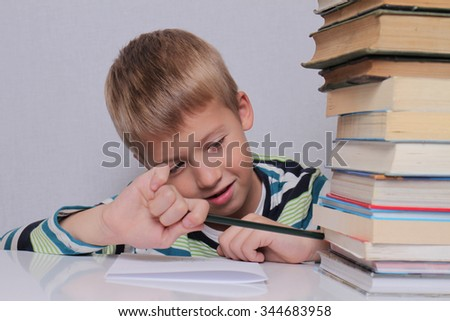 Cute eight years old school boy doing homework. Education concept - stock photo