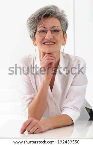 Cute, elderly woman with happy face