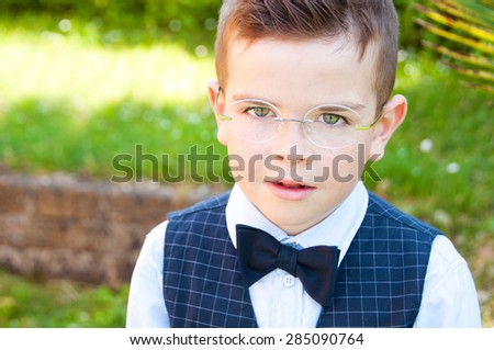 Cute elegant child dressed up in suite and bow tie