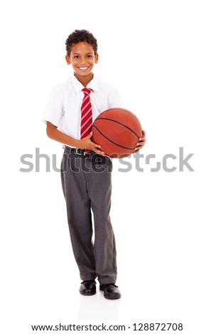 cute elementary schoolboy holding a basket ball isolated on white