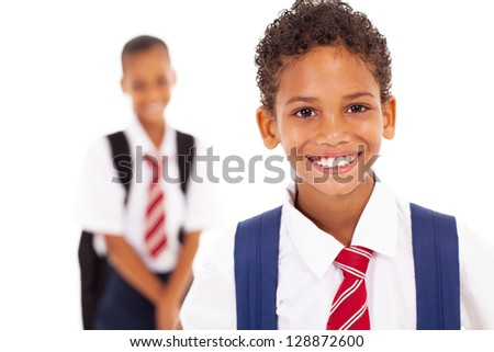 cute elementary schoolboy in front of classmate - stock photo