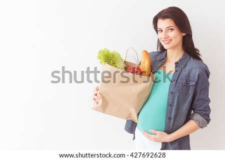 Cute expectant mother is going shopping - stock photo