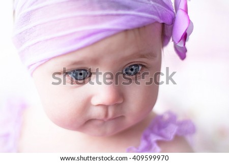 cute face girl in lavender dress with flower headband  - stock photo