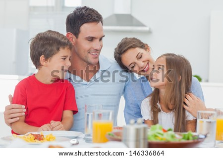 Cute family during the dinner at the table at home - stock photo