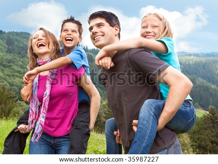 cute family having fun in the nature - stock photo