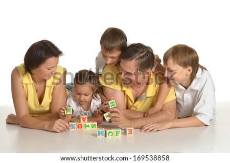 Cute family of a five playing on white
