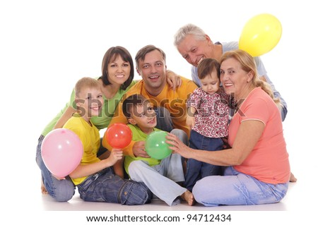 cute family of a six with balloons